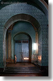 archways, buildings, candles, churches, doors, ecuador, equator, latin america, materials, praying, quito, religious, slow exposure, structures, vertical, womens, woods, photograph