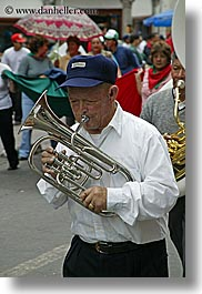 baseball cap, clothes, ecuador, equator, french, french horn, hats, horns, instruments, latin america, men, music, quito, vertical, photograph
