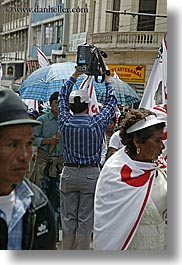 crowds, ecuador, equator, latin america, men, quito, vertical, videographer, photograph