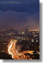 cityscapes, clouds, ecuador, equator, fog, latin america, light streaks, lights, long exposure, nature, nite, quito, sky, traffic, transportation, vertical, photograph