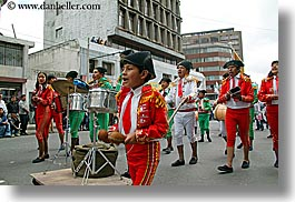 clothes, ecuador, equator, families, hats, horizontal, latin america, parade, people, quito, red, uniforms, photograph