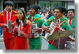 clothes, ecuador, equator, green, hats, horizontal, latin america, musicians, people, quito, red, uniformed, uniforms, photograph