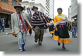dressed, ecuador, emotions, equator, horizontal, humor, latin america, people, quito, strangely, walking, photograph