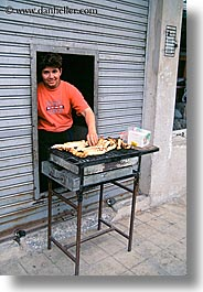 ecuador, emotions, equator, grill, latin america, people, quito, sausage, smiles, vertical, womens, photograph