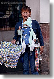 babies, ecuador, equator, latin america, lottery, people, quito, selling, tickets, vertical, womens, photograph