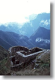 ancient ruins, andes, architectural ruins, inca trail, incan tribes, latin america, mountains, peru, phuyupatamarka, stone ruins, vertical, photograph