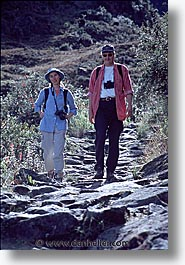 ancient ruins, andes, architectural ruins, bren, chucks, inca trail, incan tribes, latin america, mountains, people, peru, stone ruins, vertical, photograph