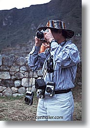 ancient ruins, andes, architectural ruins, cameras, inca trail, incan tribes, latin america, marco, mountains, people, peru, stone ruins, vertical, photograph