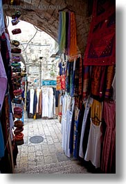 archways, clothes, hangings, israel, jerusalem, merchandise, middle east, vertical, photograph