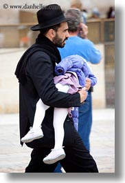 carrying, clothes, girls, hats, israel, jerusalem, jewish, men, middle east, people, religious, vertical, photograph