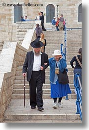 cells, clothes, hats, israel, jerusalem, jewish, men, middle east, people, phones, religious, vertical, womens, photograph