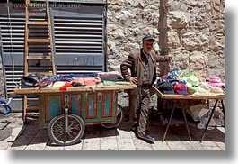 beret, clothes, hats, horizontal, israel, jerusalem, men, middle east, people, selling, stuff, photograph