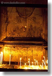 buildings, candles, catholic, churches, glow, holy sepulchre, israel, jerusalem, lamps, lights, middle east, religious, religious sites, structures, vertical, walls, photograph