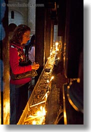 buildings, candles, catholic, churches, glow, holy sepulchre, israel, jerusalem, lighting, lights, middle east, religious, religious sites, structures, vertical, womens, photograph