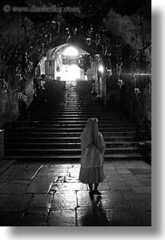 black and white, buildings, catholic, christian, churches, glow, israel, jerusalem, lights, marys tomb, middle east, nuns, religious, religious sites, stairs, structures, vertical, walking, photograph
