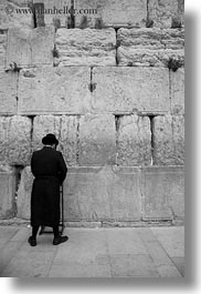 black and white, clothes, hats, israel, jerusalem, jewish, men, middle east, praying, religious, temples, vertical, walls, western wall, photograph