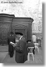 black and white, clothes, hats, israel, jerusalem, jewish, men, middle east, praying, religious, temples, vertical, western wall, photograph