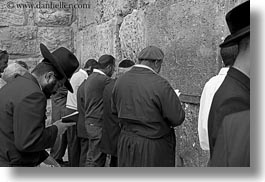 beards, black and white, clothes, hats, horizontal, israel, jerusalem, jewish, men, middle east, people, praying, religious, temples, walls, western, western wall, photograph