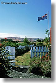 bayof islands, fences, flags, new zealand, picket, vertical, photograph