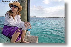 bahamas, capital, capital city, caribbean, cities, dan jill, dock, horizontal, island-nation, islands, jills, nassau, nation, resort, royal bahamian, sandals, sitting, tropics, vacation, photograph