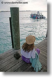 bahamas, capital, capital city, caribbean, cities, dan jill, dock, island-nation, islands, jills, nassau, nation, resort, royal bahamian, sandals, sitting, tropics, vacation, vertical, photograph