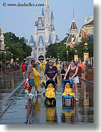 america, babies, disney, florida, magic kingdom, north america, orlando, rain, united states, vertical, walk, photograph