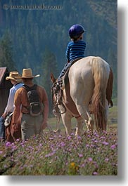 activities, america, boys, childrens, clothes, hats, helmets, horseback riding, horses, idaho, jacks, north america, people, red horse mountain ranch, riding, united states, vertical, photograph