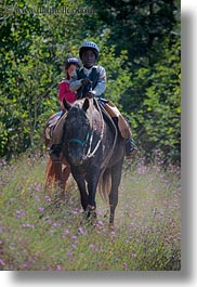 activities, america, boys, childrens, clothes, flowers, hats, helmets, horseback riding, horses, idaho, nature, north america, people, red horse mountain ranch, riding, united states, vertical, wildflowers, photograph