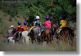 activities, america, boys, childrens, clothes, hats, helmets, horizontal, horseback riding, horses, idaho, north america, people, red horse mountain ranch, riding, united states, photograph