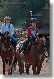 activities, america, boys, childrens, clothes, cowboy hat, hats, helmets, horseback riding, horses, idaho, north america, people, red horse mountain ranch, riding, united states, vertical, womens, photograph