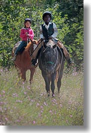 activities, america, boys, childrens, clothes, flowers, girls, hats, helmets, horseback riding, horses, idaho, nature, north america, people, red horse mountain ranch, riding, united states, vertical, wildflowers, photograph