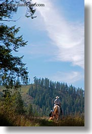 activities, america, clothes, cowboy hat, hats, horseback riding, horses, idaho, north america, people, red horse mountain ranch, riding, united states, vertical, photograph