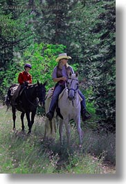 activities, america, boys, childrens, clothes, cowboy hat, forests, hats, horseback riding, horses, idaho, nature, north america, people, plants, red horse mountain ranch, riding, trees, united states, vertical, womens, photograph