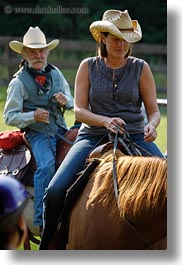 activities, america, clothes, cowboy hat, hats, horseback riding, horses, idaho, men, north america, people, red horse mountain ranch, tony, united states, vertical, womens, photograph