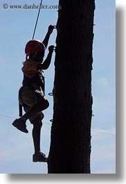 activities, america, boys, childrens, christian, climbing, clothes, hats, helmets, idaho, north america, people, red horse mountain ranch, tree climb, trees, united states, vertical, photograph