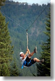 activities, america, clothes, from, hats, helmets, idaho, men, nature, north america, plants, red horse mountain ranch, swinging, trees, united states, vertical, zip line, zipline, photograph
