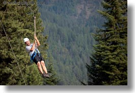 activities, america, clothes, from, hats, helmets, horizontal, idaho, men, nature, north america, plants, red horse mountain ranch, swinging, trees, united states, zip line, zipline, photograph