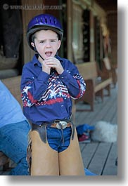 america, boys, childrens, clothes, hats, helmets, idaho, north america, people, red horse mountain ranch, riding, united states, vertical, photograph