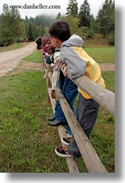 america, boys, childrens, fences, idaho, north america, people, red horse mountain ranch, united states, vertical, photograph