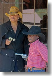 america, boys, childrens, christian, clothes, cowboy hat, fight, guns, hats, idaho, laura, mothers, north america, people, red horse mountain ranch, straw hat, united states, vertical, womens, photograph