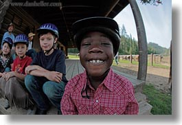 america, boys, childrens, clothes, emotions, fisheye lens, happy, hats, helmets, horizontal, idaho, north america, people, red horse mountain ranch, smiles, stables, united states, photograph