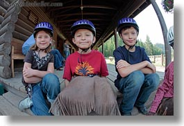 america, boys, childrens, clothes, emotions, fisheye lens, girls, happy, hats, helmets, horizontal, idaho, north america, people, red horse mountain ranch, smiles, stables, united states, photograph