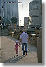 america, chicago, fathers, girls, illinois, men, north america, people, united states, vertical, walking, photograph