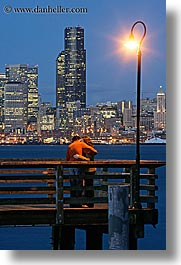 activities, america, buildings, cityscapes, couples, emotions, kissing, lamp posts, long exposure, nite, north america, pacific northwest, piers, romantic, seattle, structures, united states, vertical, washington, western usa, photograph