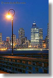 america, buildings, cityscapes, lamp posts, long exposure, nite, north america, pacific northwest, piers, seattle, structures, united states, vertical, washington, western usa, photograph