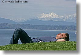 america, grass, horizontal, men, mountains, nature, north america, pacific northwest, people, seattle, sleeping, snowcaps, united states, washington, western usa, photograph