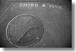 america, black and white, horizontal, manhole covers, manholes, north america, pacific northwest, pines, seattle, streets, third, united states, washington, western usa, photograph