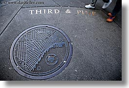 america, horizontal, manhole covers, manholes, north america, pacific northwest, pines, seattle, streets, third, united states, washington, western usa, photograph